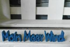 Schriftzug Statement Blau Maritim